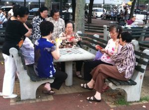asian women playing cards