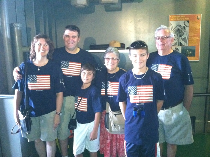 a family wearing flag shirts