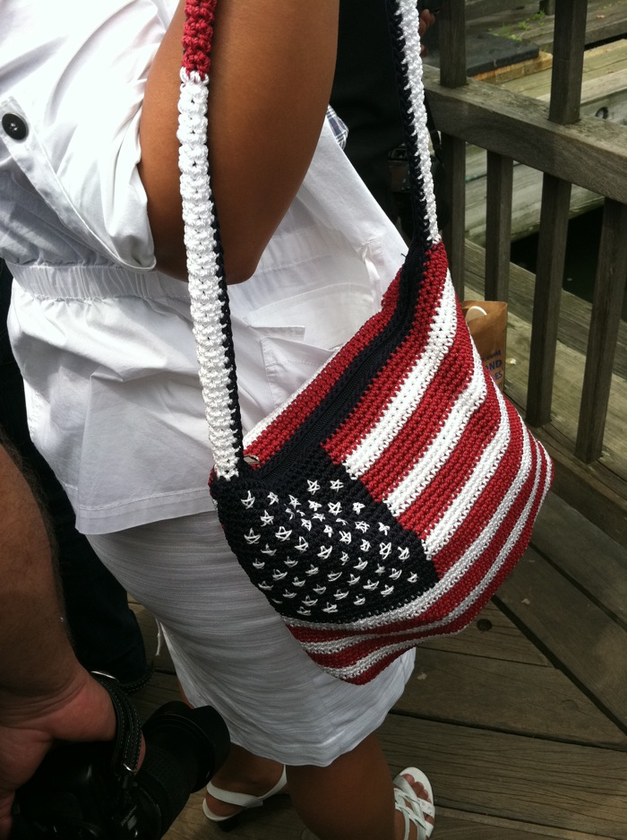 girl carrying flag purse