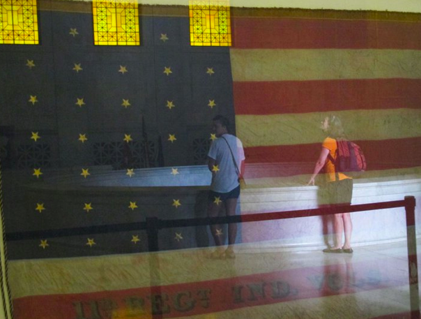 american flog reflected on glass Grants' Tomb in NYC
